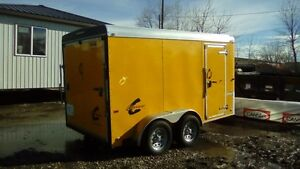 2 Yellow and Black Cargo Trailers