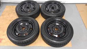4 pneus d'hiver 205/55/R16 HANKOOK comme neufs sur rimes 5x114,3