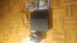 Ps4 (2 controllers + 2 games + charging station)