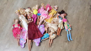 barbie dolls with clothes, accessories, furniture, etc.