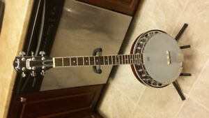 6 string Fender rusted banjo and Fender acoustic guitar.