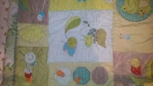 Crib quilt with skirt and mattress protector