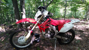 2009 CRF450X- all stock, mature woods rider, needs nothing