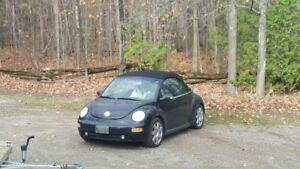 Black VW Beetle Convertible, for sale or trade.