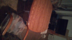 Oak table with leaf and 4 swivel chairs to match