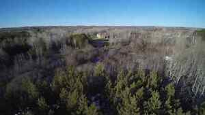 Aerial photo real estate waterfront farm acreage lot for sale