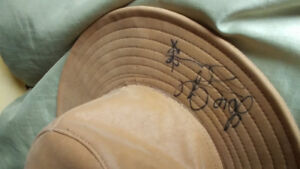 Cowboy hat signed by 3 country music artists