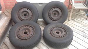 Winter tires on rims - P215/70R-15
