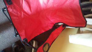 Lawn chairs band new just out of bags..one red..I've blue