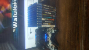 PS4 slim 10 games 2 controllers and charge tower