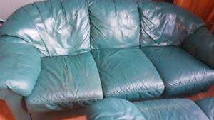 Green leather couch and love seat