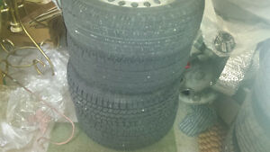 Four snow tires with rim for sale London Ontario image 1