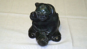 Green Stone Statue of a North American and Seal Made by Aardvark