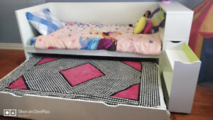 Ikea single bed with pullout extra bed underneath.