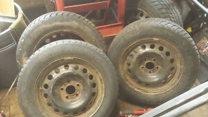 4  16 inch winter tires on pontiac rims for sale.