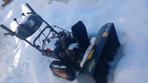 Running snowblower