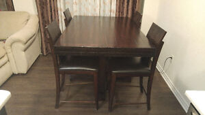 5 piece dining set made of solid wood.