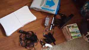 Wii, 4 remotes, nunchucks, wii Fit 14 games