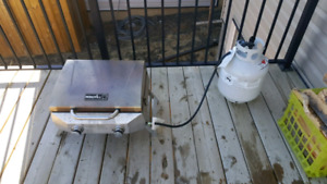 **LOWERED PRICE** Deck, Portable BBQ and Propane Tank.