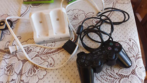 X box Game Paddle and Charger for 2 remotes Cornwall Ontario image 1