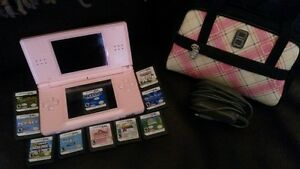 Nintendo DS with charger, case, and 10 games
