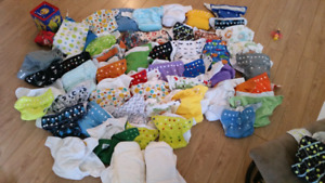 48 Cloth Diapers, over 100 inserts and two wet bags