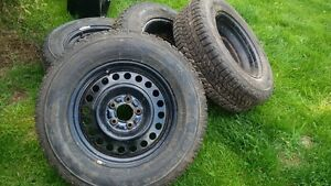 215/70/16 Firestone winterforce rims and tires