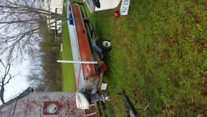 14 boat, 9.5 hp evinrude and trailer.