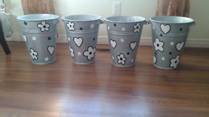 Large flower pots that can be redecorated$10 each or $30 for all