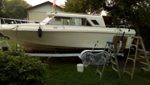 24 ft boat trade for snowmobile or motorcycle