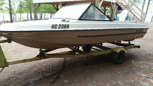 14 foot motorboat, trailer and 70 Johnson outboard