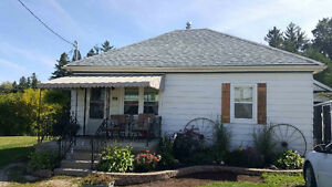 Beautiful updated bungalow on large mature lot