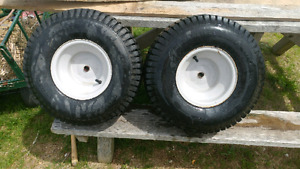 Lawn tractor tires with rims