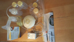 Medela Swing Breast Pump + Save Breast Milk Bags-20 pack (free+)