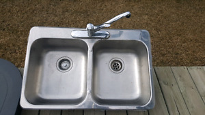 Stainless steel double sink with faucet