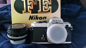 Nikon FE with 50mm lens and manuals