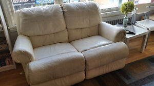 Beige leather love seat couch with recliner