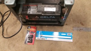 "Delta 12"" thickness planer with new blades and gauges"