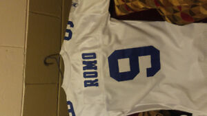 4 new Nfl jerseys with tags and one nhl jersey new with tags