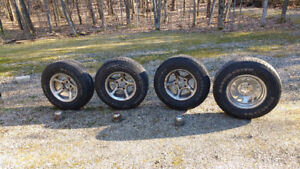 4 lightly used truck tires on steel rims