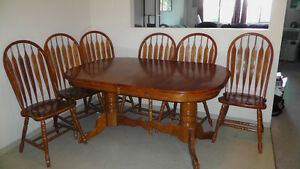 Medium brown table with 6 chairs