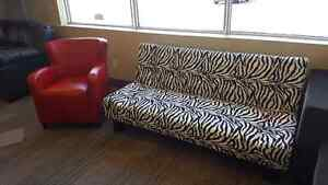 Zebra print fouton and red accent chair