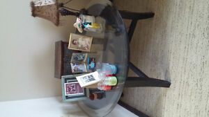 Glass round table with black wooden legs