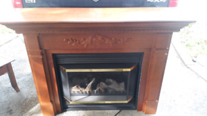 Electric fireplace with mantle and beautiful frame