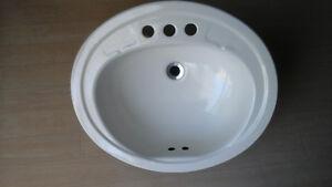 3 Oval sink 1 w gasket drain closer  2 sink no gasket drain clos
