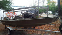 tracker 1436 jon boat with 15 hp motor and trailer