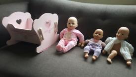 Dolls x3 and beautuful pink rocking crib