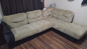 Sectional couche with minor pet damage.