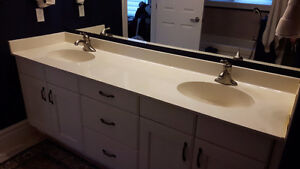 One single, one double composite resin vanity counter top