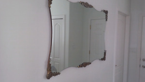Large vintage wall mirror with brass corners